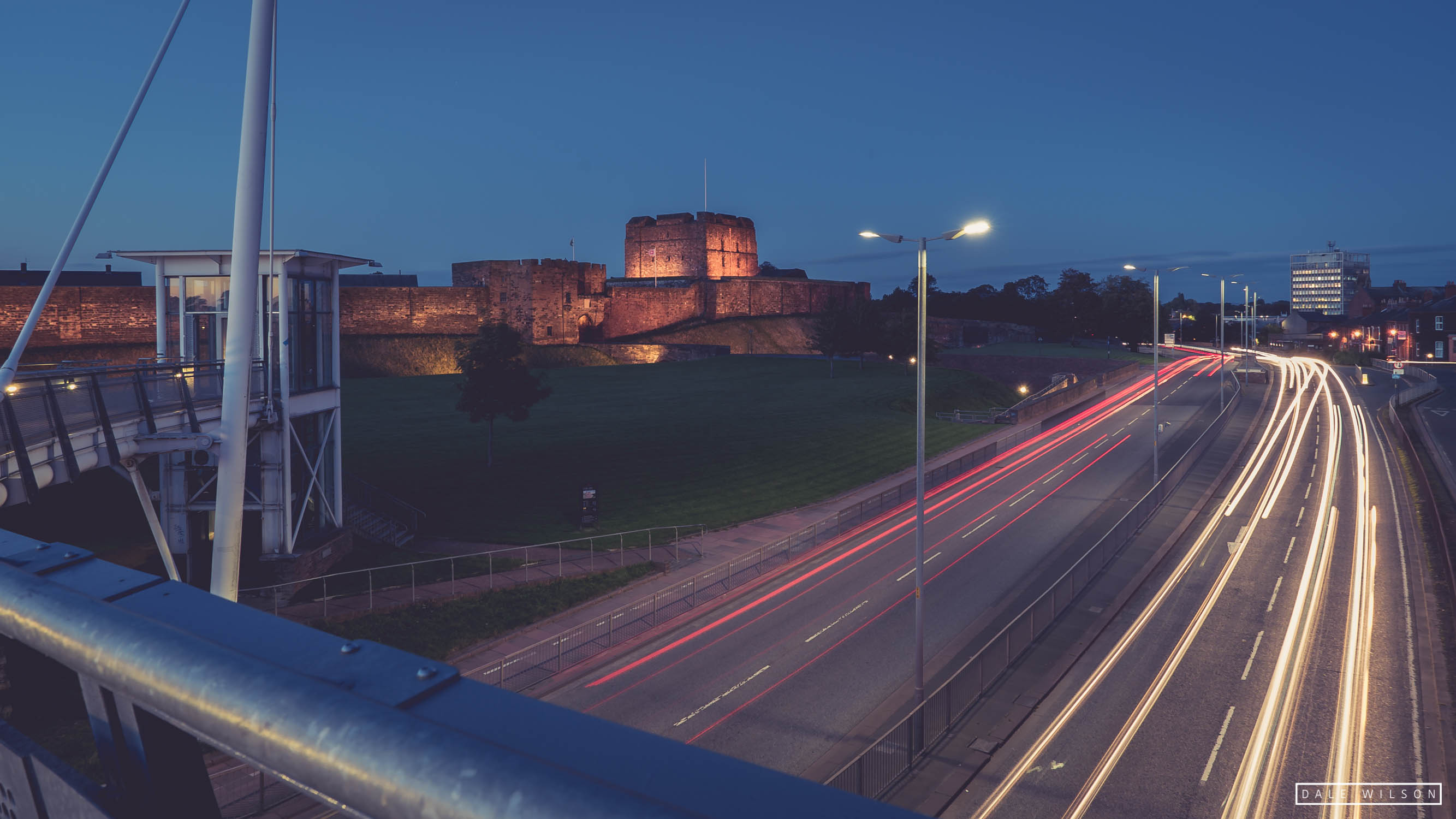 Carlisle Castle with long exposure of cars under the Millennium Bridge Castle Way Carlisle.