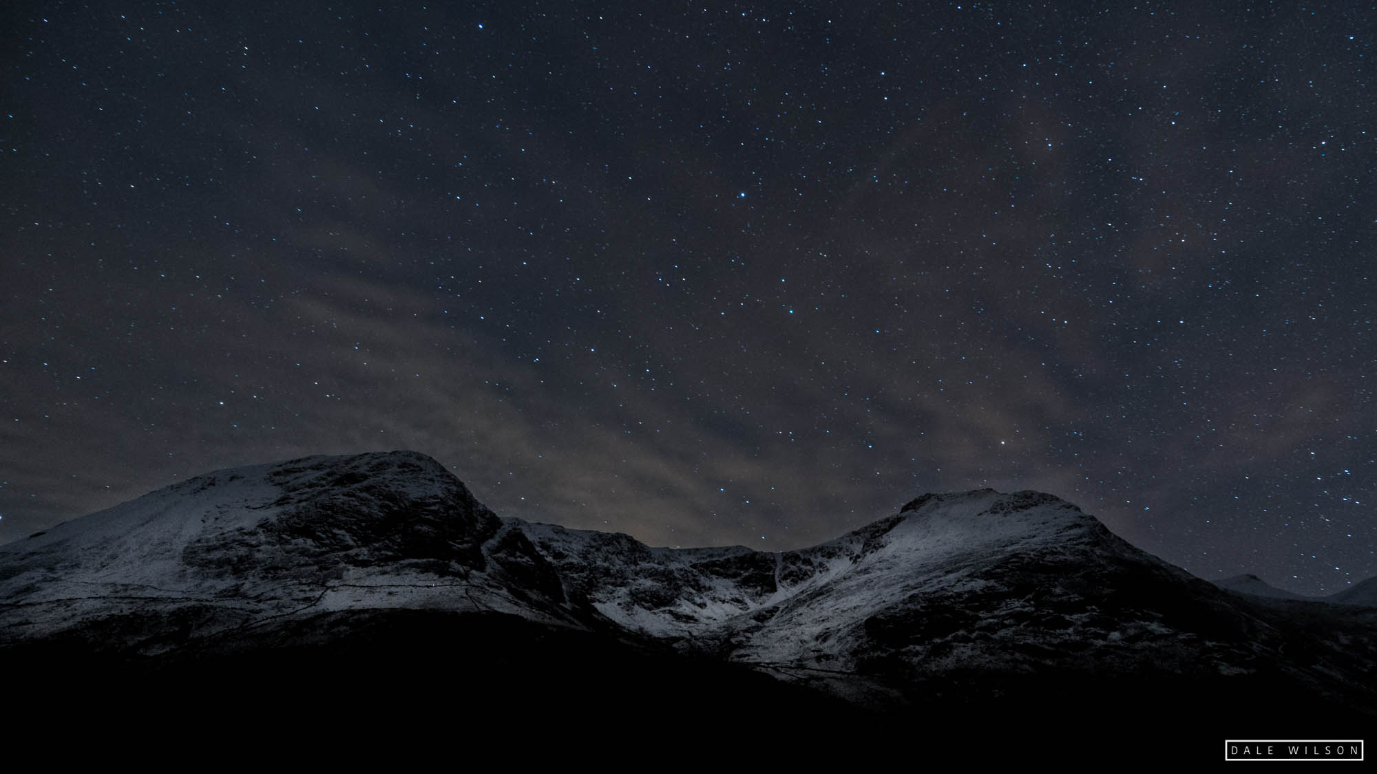 Snow on the mountains and starry sky Haystacks and Buttermere